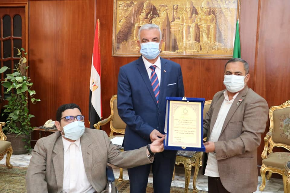 Mubarak receives the shield of humanitarian ambassadors from the Arab International Festival for People with Special Needs.